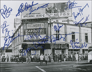 FILLMORE WEST - AUTOGRAPHED SIGNED PHOTOGRAPH CO-SIGNED BY: JOHN KAY, BONNIE BRAMLETT, GARY DUNCAN, COUNTRY JOE & THE FISH (JOE McDONALD), SLY AND THE FAMILY STONE (CYNTHIA ROBINSON), SLY AND THE FAMILY STONE (JERRY MARTINI), YOUNG RASCALS (DINO DANELLI), YOUNG RASCALS (GENE CORNISH), RICK DERRINGER, POCO (PAUL COTTON), POCO (RUSTY YOUNG), THE DOORS (ROBBY KRIEGER)