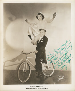 LARRY AND LYNN, KING AND QUEEN OF THE UNICYCLE - AUTOGRAPHED INSCRIBED PHOTOGRAPH