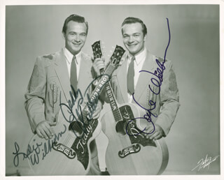 THE WILBURN BROTHERS - AUTOGRAPHED SIGNED PHOTOGRAPH CO-SIGNED BY: WILBURN BROTHERS (DOYLE WILBURN), THE WILBURN BROTHERS (TEDDY WILBURN), LESLIE WILBURN