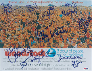 WOODSTOCK - AUTOGRAPHED SIGNED PHOTOGRAPH CO-SIGNED BY: JEFFERSON AIRPLANE (MARTY BALIN), JOHN SEBASTIAN, JOE COCKER, CROSBY, STILLS & NASH (STEPHEN STILLS), TOM CONSTANTEN, JOHNNY WINTER, WAVY GRAVY, COUNTRY JOE & THE FISH (JOE McDONALD), SLY AND THE FAMILY STONE (CYNTHIA ROBINSON), SLY AND THE FAMILY STONE (JERRY MARTINI), JUMA SULTAN, MELANIE