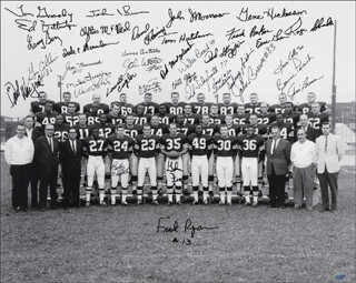 CLEVELAND BROWNS - AUTOGRAPHED SIGNED PHOTOGRAPH CIRCA 1964 CO-SIGNED BY: JIM BROWN, LEROY KELLY, MIKE LUCCI, DICK SCHAFRATH, GARY COLLINS, WALTER BEACH, LARRY BENZ, LOWELL CAYLOR, ROSS FICHTNER, BILL GLASS, TOM GOOSBY, GENE HICKERSON, DICK MODZELEWSKI, JIM NINOWSKI, FRANK PARKER, BERNIE PARRISH, PAUL WIGGIN