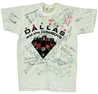 Autographs: FIRST LADY NANCY DAVIS REAGAN - SHIRT SIGNED CO-SIGNED BY: MICKEY GILLEY, DIANE McBAIN, EVELYN LEAR, THOMAS STEWART, CESAR ROMERO, JOHNNY LEE, BOB CRANE, GLORIA SWANSON, COLONEL WALTER CUNNINGHAM, BUTTERFLY McQUEEN, ROBERT MORSE, EMILIO MARCHESE DI BARSENTO PUCCI, ROY HEAD, FLOYD TILLMAN, ARCHIE CAMPBELL, BILL DUFTY, BRIAN PINETTE, RON STONE, (ROY HALSTON FROWICK) HALSTON, SHARON SPEER, BETTY EWING, TONY ULLRICH, PAUL SCHMITT, MICHAEL VOLLBRACHT, HAROLD GUNN