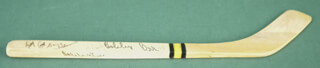 BOBBY ORR - MINIATURE HOCKEY STICK SIGNED CO-SIGNED BY: MILT SCHMIDT, EDDIE THE NOSE SHACK, TERRY CRISP, GARY SABOURIN