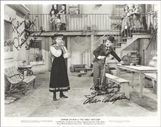 Autographs: GREAT DICTATOR MOVIE CAST - PHOTOGRAPH SIGNED CIRCA 1940 CO-SIGNED BY: PAULETTE GODDARD, CHARLIE THE LITTLE TRAMP CHAPLIN