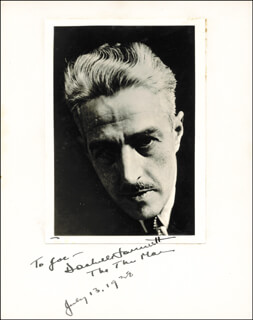 DASHIELL (SAMUEL) HAMMETT - INSCRIBED PHOTOGRAPH MOUNT SIGNED 07/13/1938