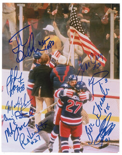 1980 US OLYMPIC HOCKEY TEAM - AUTOGRAPHED SIGNED PHOTOGRAPH CO-SIGNED BY: BUZZ SCHNEIDER, JIM CRAIG, MIKE ERUZIONE, JOHN HARRINGTON, STEVE JANASZAK, JACK O'CALLAHAN, KEN MORROW, MARK JOHNSON, PHIL VERCHOTA, CRAIG PATRICK