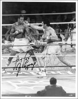 LARRY HOLMES - AUTOGRAPHED SIGNED PHOTOGRAPH 1987 CO-SIGNED BY: GERRY COONEY