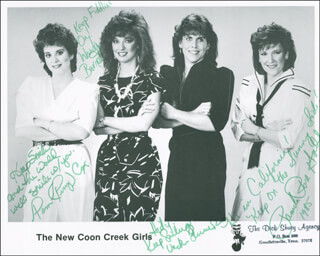 NEW COON CREEK GIRLS - AUTOGRAPHED INSCRIBED PHOTOGRAPH 1985 CO-SIGNED BY: NEW COON CREEK GIRLS (VICKI SIMMONS), NEW COON CREEK GIRLS (PAM PERRY [COX]), NEW COON CREEK GIRLS (PAMELA ROSE GADD), NEW COON CREEK GIRLS (WENDY BARNETT)