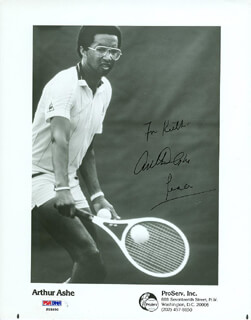 ARTHUR ASHE - INSCRIBED PRINTED PHOTOGRAPH SIGNED IN INK