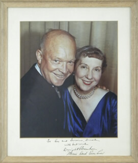 PRESIDENT DWIGHT D. EISENHOWER - INSCRIBED PHOTOGRAPH MOUNT SIGNED CO-SIGNED BY: FIRST LADY MAMIE DOUD EISENHOWER