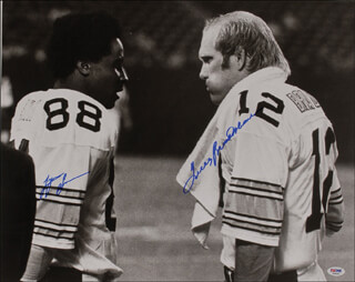 Autographs: TERRY BRADSHAW - PHOTOGRAPH SIGNED CO-SIGNED BY: LYNN SWANN