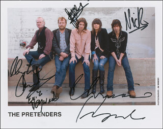 THE PRETENDERS - AUTOGRAPHED SIGNED PHOTOGRAPH CO-SIGNED BY: THE PRETENDERS (CHRISSIE HYNDE), THE PRETENDERS (MARTIN CHAMBERS), THE PRETENDERS (NICK WILKINSON ), THE PRETENDERS (JAMES WALBOURNE), THE PRETENDERS (ERIC HEYWOOD)