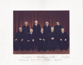 THE WILLIAM H. REHNQUIST COURT - PHOTOGRAPH MOUNT SIGNED CO-SIGNED BY: ASSOCIATE JUSTICE BYRON R. WHITE, ASSOCIATE JUSTICE ANTONIN SCALIA, ASSOCIATE JUSTICE LEWIS F. POWELL JR., ASSOCIATE JUSTICE SANDRA DAY O'CONNOR, ASSOCIATE JUSTICE WILLIAM J. BRENNAN JR., CHIEF JUSTICE WILLIAM H. REHNQUIST, ASSOCIATE JUSTICE HARRY A. BLACKMUN, ASSOCIATE JUSTICE JOHN PAUL STEVENS