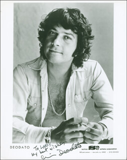 DEODATO (EUMIR DEODATO DE ALMEIDA) - INSCRIBED PRINTED PHOTOGRAPH SIGNED IN INK
