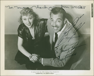 CARNIVAL IN COSTA RICA MOVIE CAST - AUTOGRAPHED INSCRIBED PHOTOGRAPH CO-SIGNED BY: CESAR ROMERO, CELESTE HOLM