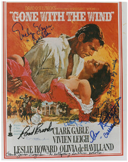 GONE WITH THE WIND MOVIE CAST - PRINTED PHOTOGRAPH SIGNED IN INK CO-SIGNED BY: CAMMIE KING, MARJORIE REYNOLDS, RAND BROOKS, ANN RUTHERFORD, ERIC LINDEN, EVELYN KEYES, BUTTERFLY McQUEEN, FRANK COGHLAN JR.