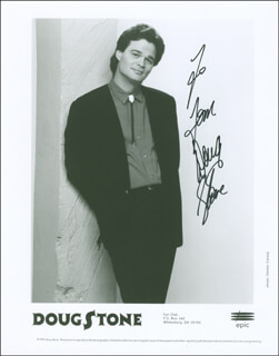 DOUG STONE - INSCRIBED PRINTED PHOTOGRAPH SIGNED IN INK