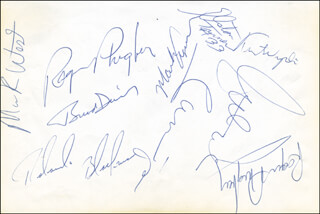 DALLAS MAVERICKS - AUTOGRAPH CO-SIGNED BY: ELSTON TURNER, ROLANDO BLACKMAN, MARK AGUIRRE, DALE ELLIS, DEREK HARPER, BRAD DAVIS, BILL GARNETT, KURT NIMPHIUS, ROGER PHEGLEY, PATRICK CUMMINGS