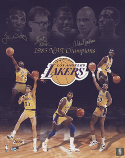 THE LOS ANGELES LAKERS - AUTOGRAPHED SIGNED PHOTOGRAPH CO-SIGNED BY: JAMES A. WORTHY, KURT RAMBIS, KAREEM ABDUL-JABBAR