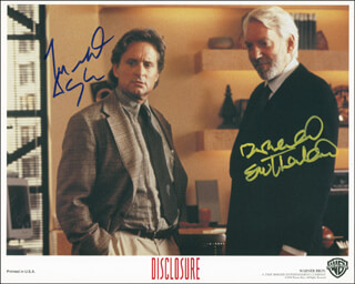 DISCLOSURE MOVIE CAST - AUTOGRAPHED SIGNED PHOTOGRAPH CO-SIGNED BY: MICHAEL DOUGLAS, DONALD SUTHERLAND