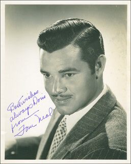 THOMAS NEAL - AUTOGRAPHED INSCRIBED PHOTOGRAPH