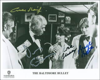 THE BALTIMORE BULLET MOVIE CAST - AUTOGRAPHED SIGNED PHOTOGRAPH CO-SIGNED BY: OMAR SHARIF, BRUCE BOXLEITNER, JAMES COBURN, RONEE BLAKLEY