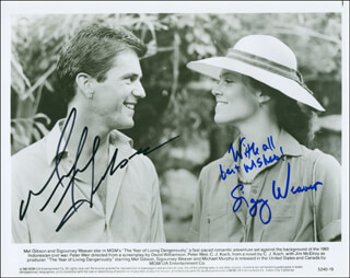 THE YEAR OF LIVING DANGEROUSLY MOVIE CAST - AUTOGRAPHED SIGNED PHOTOGRAPH CO-SIGNED BY: MEL GIBSON, SIGOURNEY WEAVER