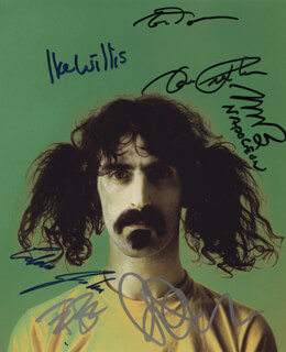 THE MOTHERS OF INVENTION - AUTOGRAPHED SIGNED PHOTOGRAPH CO-SIGNED BY: THE MOTHERS OF INVENTION (NAPOLEON MURPHY BROCK), THE MOTHERS OF INVENTION (IKE WILLIS), THE MOTHERS OF INVENTION (DON PRESTON), HOWARD KAYLAN, THE MOTHERS OF INVENTION (TERRY BOZZIO), THE MOTHERS OF INVENTION (EDDIE JOBSON), THE MOTHERS OF INVENTION (TOM FOWLER), DWEEZIL ZAPPA