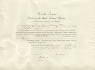 Autographs: PRESIDENT RONALD REAGAN - DOCUMENT SIGNED 10/04/1982 CO-SIGNED BY: KENNETH W. DAM