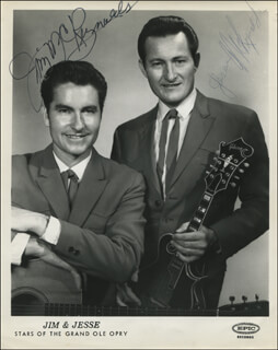 JIM & JESSE - PRINTED PHOTOGRAPH SIGNED IN INK CO-SIGNED BY: GEORGE JONES, TAMMY WYNETTE, JIM & JESSE (JIM MC REYNOLDS), JIM & JESSE (JESSE MC REYNOLDS), BOBBY LORD