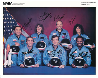 SPACE SHUTTLE CHALLENGER - STS - 51L CREW - AUTOGRAPHED SIGNED PHOTOGRAPH CO-SIGNED BY: LT. COLONEL ELLISON S. EL ONIZUKA, GREG JARVIS, RONALD E. McNAIR, LT. COLONEL DICK (FRANCIS R.) SCOBEE, CHRISTA McAULIFFE, JUDITH A. JUDY RESNIK, CAPTAIN MICHAEL J. SMITH