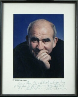 ED ASNER - INSCRIBED PHOTOGRAPH MOUNT SIGNED