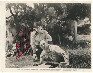 Autographs: RUSSELL ARMS - INSCRIBED PHOTOGRAPH SIGNED