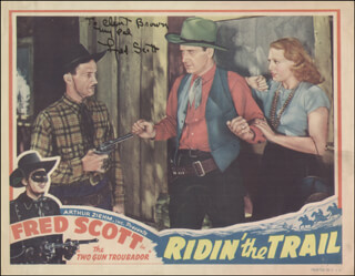 FRED L. THE SINGING BUCKAROO SCOTT - INSCRIBED LOBBY CARD SIGNED