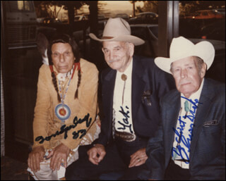 Autographs: IRON EYES CODY - INSCRIBED PHOTOGRAPH SIGNED 1983 CO-SIGNED BY: YAKIMA CANUTT, OLIVER DRAKE