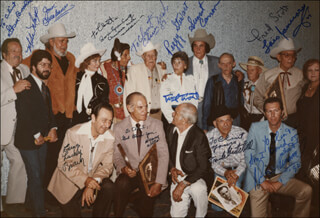 SUNSET CARSON - AUTOGRAPHED INSCRIBED PHOTOGRAPH 1990 CO-SIGNED BY: PEGGY STEWART, FRED L. THE SINGING BUCKAROO SCOTT, IRON EYES CODY, LOIS JANUARY, EWING LUCKY BROWN, OLIVER DRAKE, TERRY FROST, STEVE BRODIE, FRANK MITCHELL, HENRY WILLS