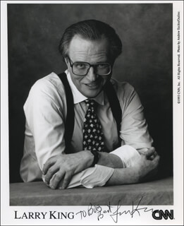 LARRY KING - INSCRIBED PRINTED PHOTOGRAPH SIGNED IN INK