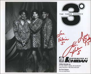 THE THREE DEGREES - AUTOGRAPHED SIGNED PHOTOGRAPH CO-SIGNED BY: THREE DEGREES (HELEN LEGGINS), THREE DEGREES (VALERIE CHRISTIE), THE THREE DEGREES (CYNTHIA GARRISON)