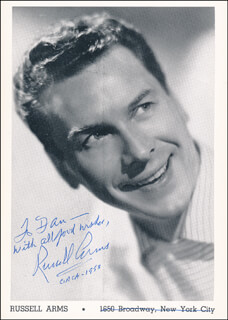 Autographs: RUSSELL ARMS - INSCRIBED PRINTED PHOTOGRAPH SIGNED IN INK