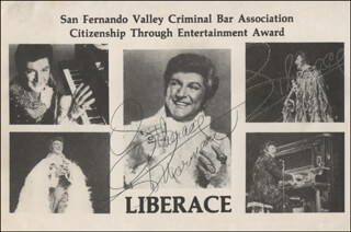 LIBERACE - INSCRIBED PRINTED PHOTOGRAPH SIGNED IN INK