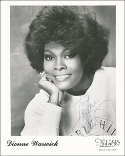 DIONNE WARWICK - INSCRIBED PRINTED PHOTOGRAPH SIGNED IN INK