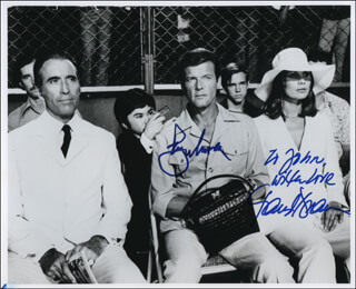 THE MAN WITH THE GOLDEN GUN MOVIE CAST - AUTOGRAPHED INSCRIBED PHOTOGRAPH CO-SIGNED BY: ROGER MOORE, MAUD ADAMS