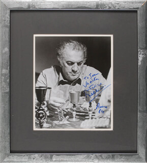 FEDERICO FELLINI - AUTOGRAPHED INSCRIBED PHOTOGRAPH 1984