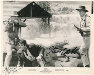 THE COMANCHEROS MOVIE CAST - INSCRIBED PRINTED PHOTOGRAPH SIGNED IN INK CO-SIGNED BY: PATRICK WAYNE, STUART WHITMAN