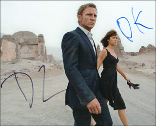 QUANTUM OF SOLACE MOVIE CAST - AUTOGRAPHED SIGNED PHOTOGRAPH CO-SIGNED BY: DANIEL CRAIG, OLGA KURYLENKO
