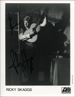 RICKY SKAGGS - INSCRIBED PRINTED PHOTOGRAPH SIGNED IN INK