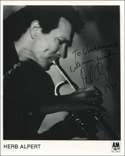 HERB ALPERT - INSCRIBED PRINTED PHOTOGRAPH SIGNED IN INK 1990