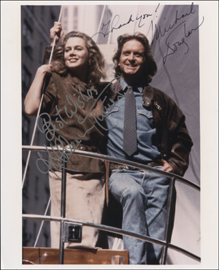ROMANCING THE STONE MOVIE CAST - AUTOGRAPHED SIGNED PHOTOGRAPH CO-SIGNED BY: MICHAEL DOUGLAS, KATHLEEN TURNER
