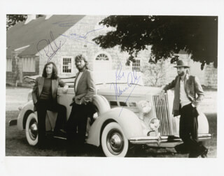 THE BEE GEES - AUTOGRAPHED SIGNED PHOTOGRAPH CO-SIGNED BY: THE BEE GEES (BARRY GIBB), THE BEE GEES (ROBIN GIBB), THE BEE GEES (MAURICE GIBB)