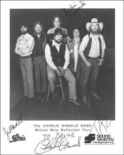 THE CHARLIE DANIELS BAND - AUTOGRAPHED INSCRIBED PHOTOGRAPH CO-SIGNED BY: THE CHARLIE DANIELS BAND (CHARLIE DANIELS), THE CHARLIE DANIELS BAND (CHARLIE HAYWARD), THE CHARLIE DANIELS BAND (JIM MARSHALL), THE CHARLIE DANIELS BAND (JOE TAZ DIGREGORIO)